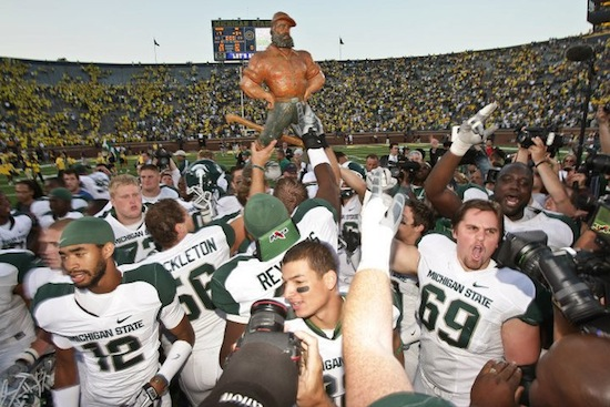 12 Paul Bunyan Trophy - Sibling Rivalry (Michigan Wolverines vs. Michigan State Spartans) weird college football trophies