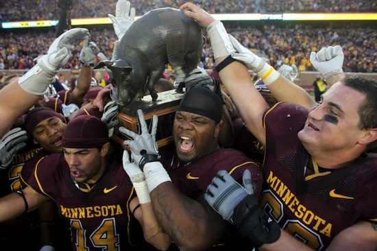 15 floyd of rosedale trophy (iowa hawkeyes vs. minnesota golden gophers) weird college football trophies