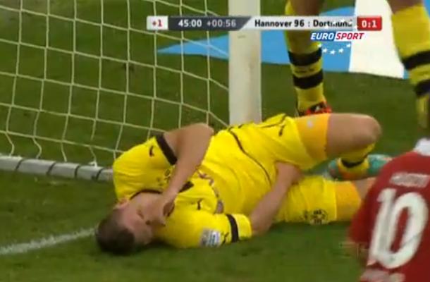Lukasz Piszczek slides into goal post crotch first