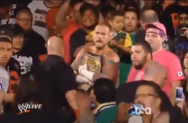 cm punk punches fan monday night raw