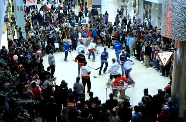 flash mob playing hockey at mall
