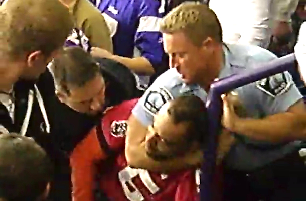 security guard puts guy in headlock at vikings game