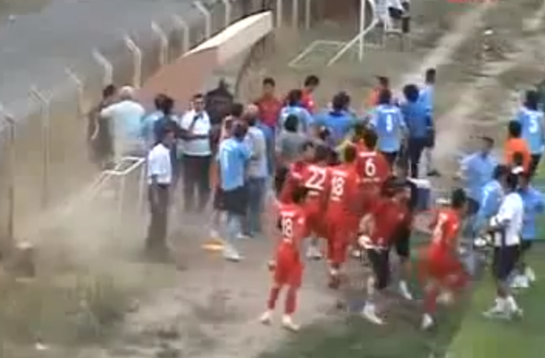 soccer referee attacks player