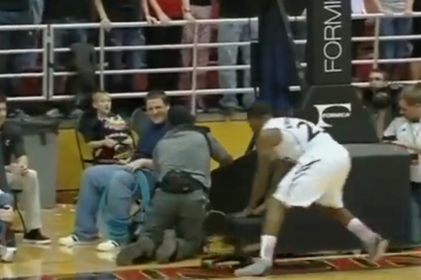 basketball player runs into cameraman