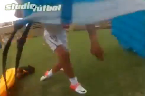 paraglider crashes into soccer player
