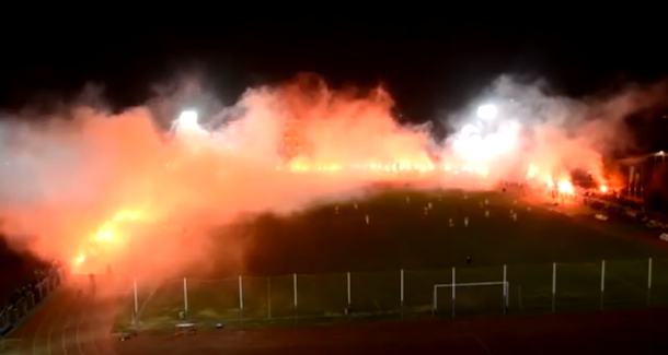 romanian soccer teams encircled by flames