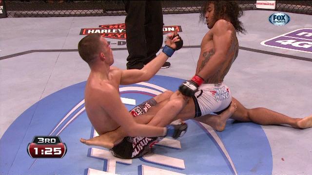 Nate Diaz giving Ben Henderson the finger