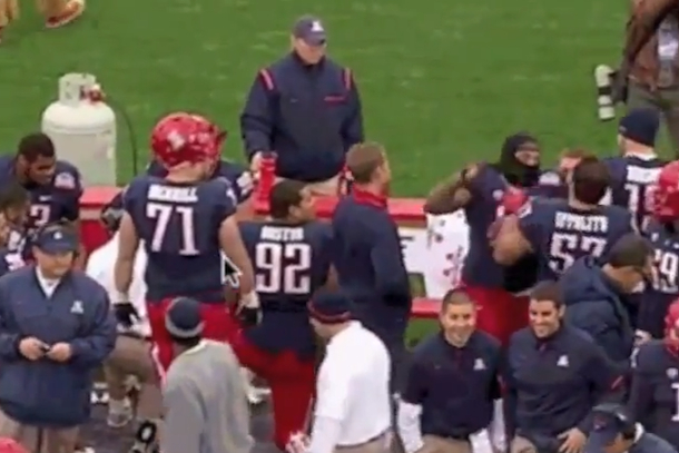 arizona football players fighting each other on sidelines