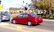 Watch This Guy Do Parkour Off Strangers' Cars Sitting in Traffic (Video)