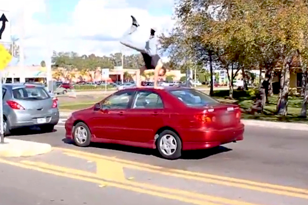 crazy parkour on strangers cars in traffic