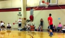 Guy Tries To Dunk Over a Basketball Rack, Fails Miserably (Video)