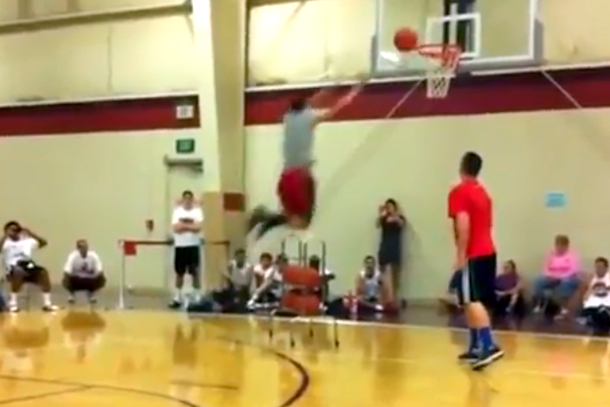 fail guy tries to dunk over ball rack