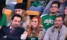 Female Celtics Fan Makes Dirty Gesture for TV Camera (Video)