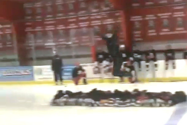 jules jardine jumping over 14 kids on ice skates