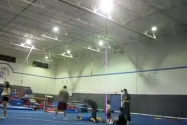 male cheerleader knocked out doing stunt