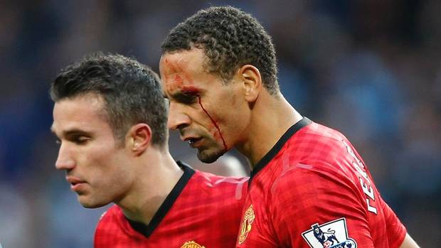 man united rio ferdinand hit by coin