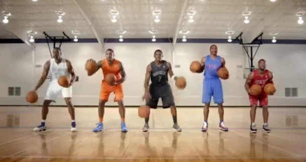 nba players playing carol of the bells with basketballs