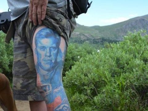 11 john elway thigh tattoo