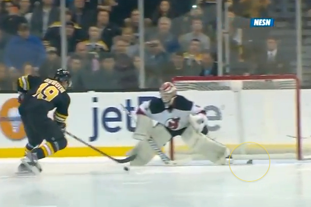 bruins fan throws hot dog on ice during shootout