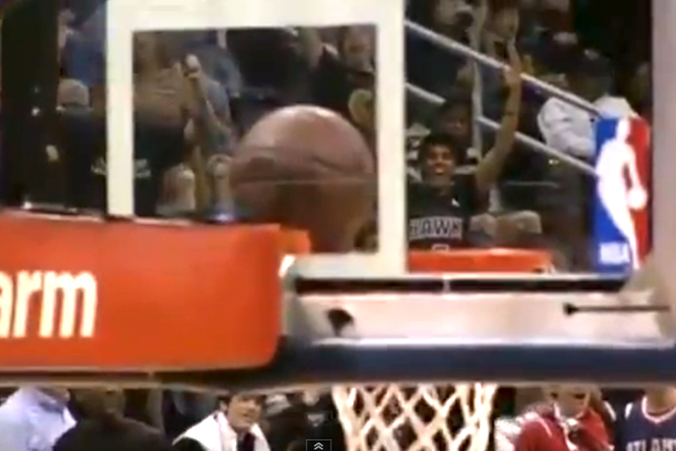 half court shot stuck between rim and backboard