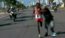 Kenyan Runner Attacked by Spectator, Still Wins the Race (Video)