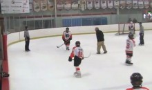 Youth Hockey Coach Jumps Over Boards to Yell at Refs, Falls on His Butt (Video)