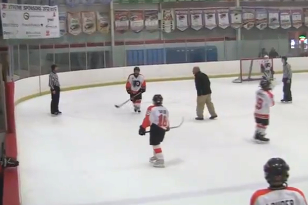 pee wee hockey coach hops over boards to yell at refs