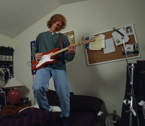 25-alexi-lalas-playing-guitar-athletes-who-were-musicians