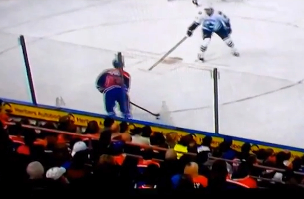 fans stack cups against glass at edmonton oilers game