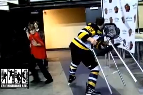 junior hockey player flips out throws chair