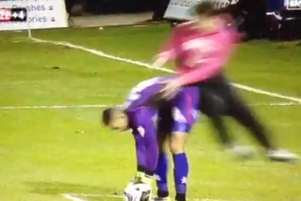 soccer fan attacks goalie