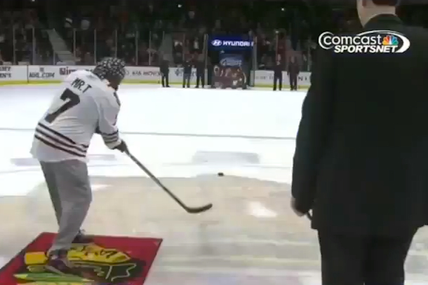 mr. t shoots puck at blackhawks game
