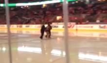 Streaker Jumps Onto Ice at Calgary Flames Game (Video)
