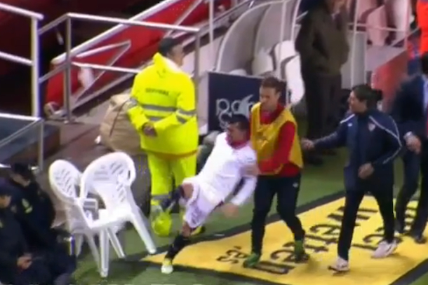 soccer player flips out kicks chair