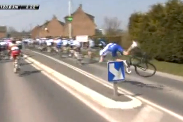 cyclist crashes into sign during paris-roubaix race