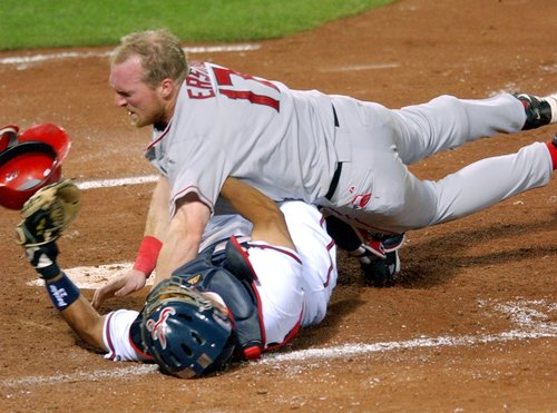 http://www.totalprosports.com/wp-content/uploads/2013/04/darin-erstad-colliding-with-johnny-estrada-epic-home-plate-collisions.jpg