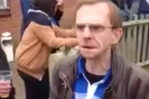 drunk belligerent soccer fan tries to start fight
