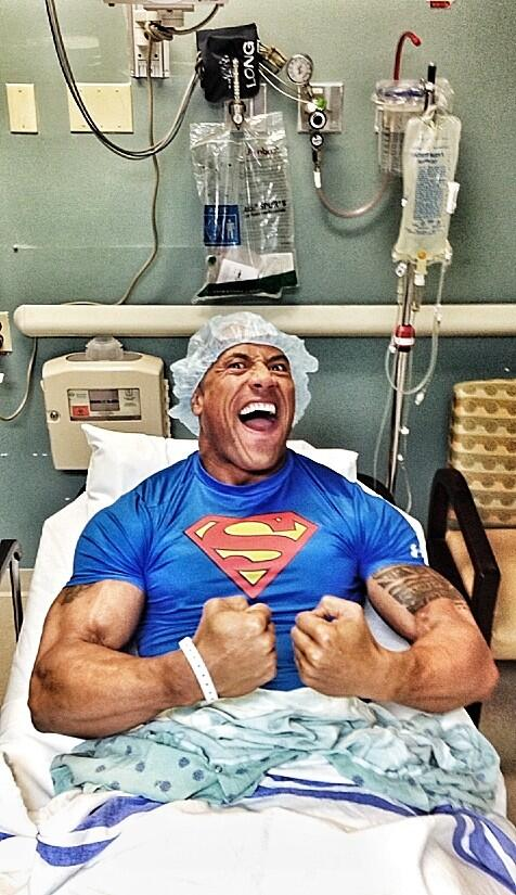 dwayne the rock johnson flexing in hospital after surgery