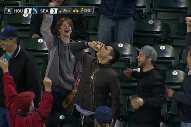 mariners fan catches foul ball in beer then chugs