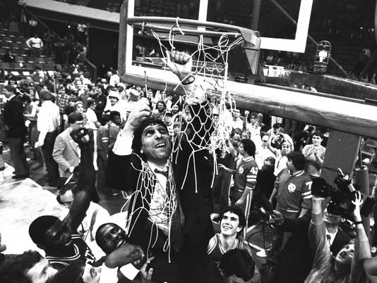 n.c. state 1983 jim valvano cutting down the nets - unlikely final four teams