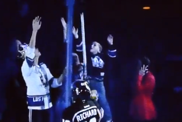 parenting fail hockey fan drops kid