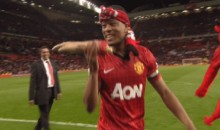 Patrice Evra Celebrates Man U's Premier League Title By Biting an Arm, à la Luis Suarez (GIF)