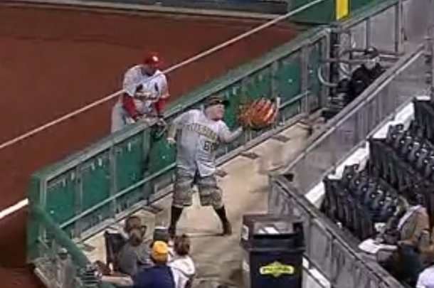 pirates fan catches foul ball with oversized glove