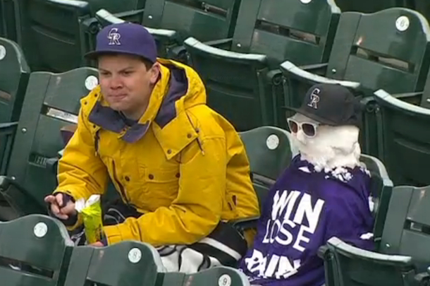 rockies fan makes snowman in stands