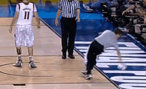 towel boy slips and falls during ncaa championship game