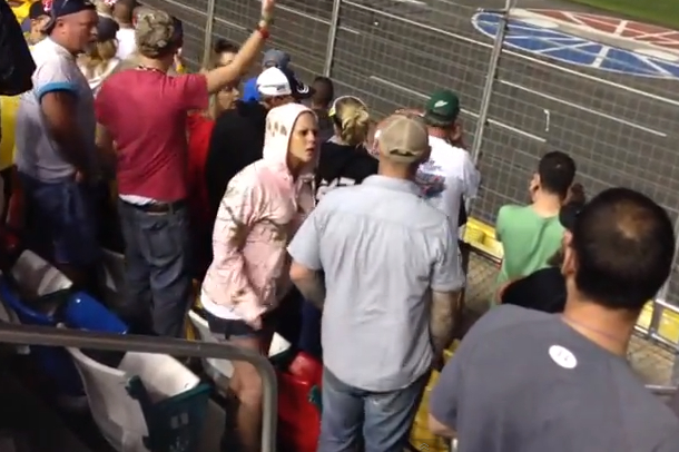 chick slaps guy in face throwing beer on race track