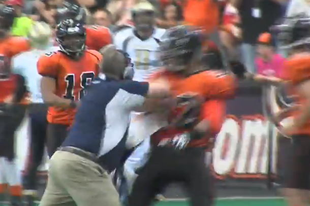 indoor football coach attacks player