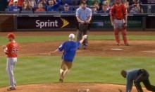 Royals Fan Runs onto Field and Steals Rosin Bag from Pitching Mound (Video)