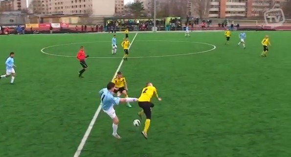 soccer player kick opponent