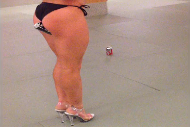 woman crushes beer can in glutes